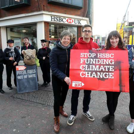 Christian Aid activists protest on Royal Avenue, urging HSBC bank to stop funding climate change.