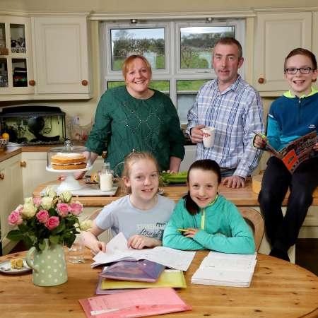 Susie Hamilton with her family in their home in Saintfield, County Down