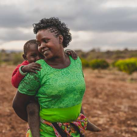 Faith Muvili and her son in Makueni County, Kenya